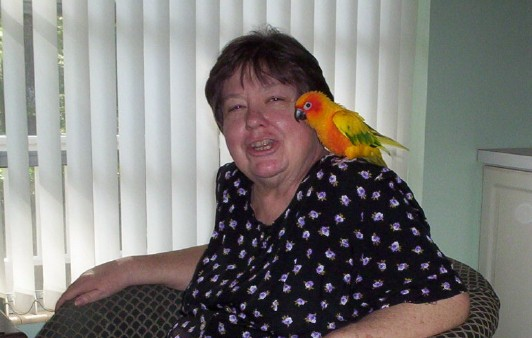 Judith at home with a feathered friend just before beginning chemotherapy two years ago.