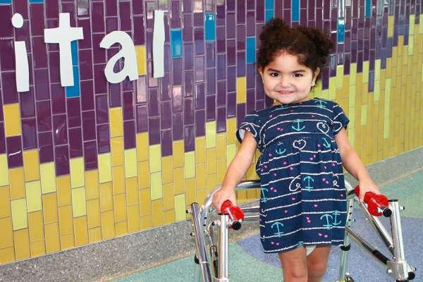Izabella Neira is pictured in the Sebastian Ferrero Atrium at UF Health Shands Children's Hospital.