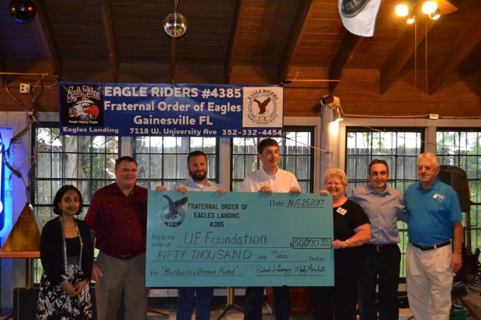 Check presentation to the Barbara's Dream Fund for Frontotemporal Dementia Fund at the University of Florida from the Fraternal Order of Eagles of Gainesville