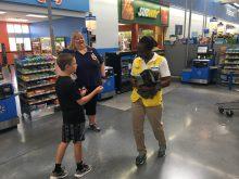CMN Ambassador Sage Pridemore chats with Walmart employees.