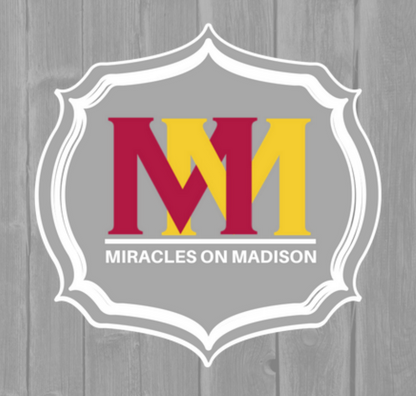 "Miracles on Madison cover photo with wood panel background, and red and yellow ""MM"" logo. White text reads ""Miracles on Madison"""