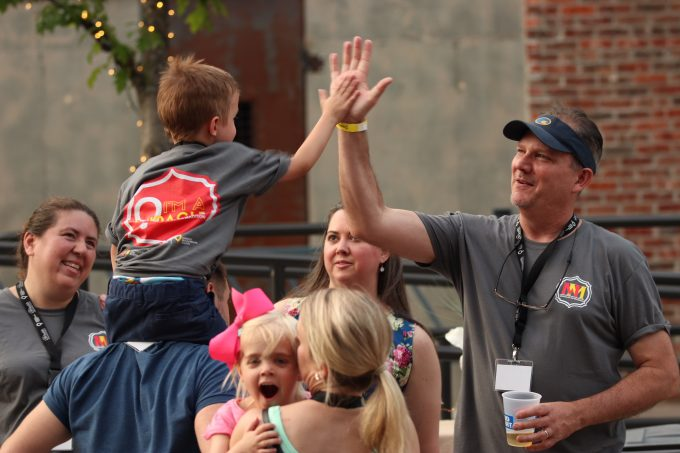 CMN Ambassador Fletcher Huddleston gives out a high-five during the Miracles on Madison event in Tallahassee, Fla.