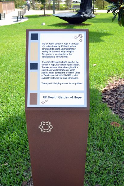 A plaque welcoming visitors to the Garden of Hope at UF Health.