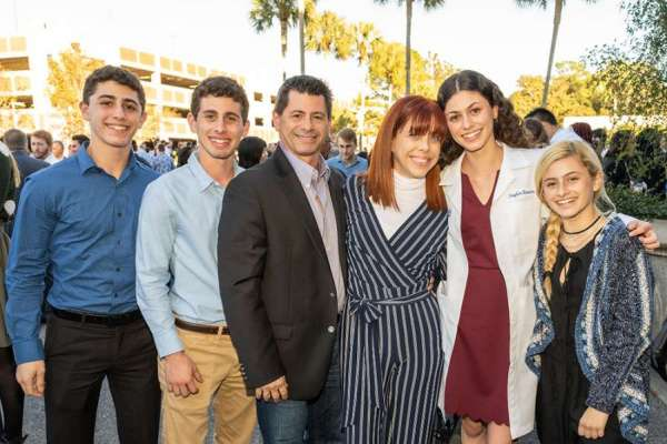 First-year UF medical student Taylor Rouviere's family traveled to Gainesville from Miami to celebrate the annual white coat ceremony. From left: Koby, Zack, Andre, Jodi, Taylor and Sydney.
