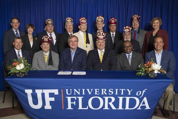 The new relationship between Shriners Hospitals for Children and UF Health was recognized Oct. 4 with a signing ceremony that included UF President Kent Fuchs, members of the SHC-Florida Board of Governors, and the members of UF Foundation Board of Directors.