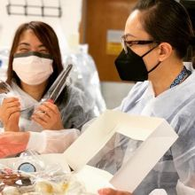 "Three UF Health nurses enjoy a sweet treat during the ""Nourish a Nurse"" campaign."