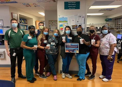 UF Health nurses pose for a photo after receiving Sonic slushes.