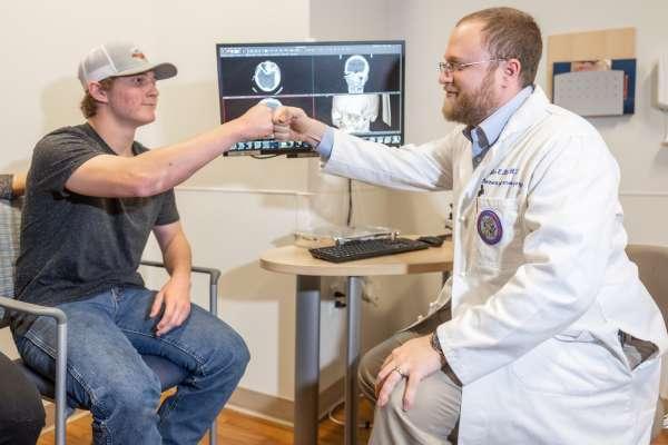UF Health pediatric traumatic brain injury patient Rylan Lord with his pediatric neurosurgeon Jason Blatt, M.D.