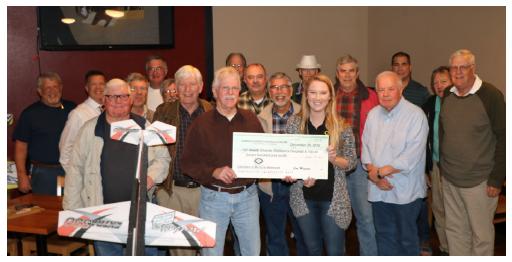 Members of the Seminole RC Club present a check to CMN Hospitals.
