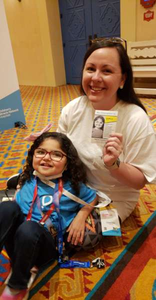 CMN Hospitals senior development associate poses for a photo with National CMN Hospitals ambassador and UF Health Shands Children's Hospital patient, Izabella.