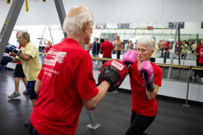 Judith Barrett spars with other class participants in her hometown gym.