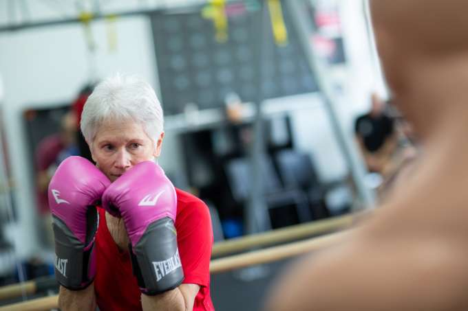 Judith Barrett spars with other boxing participants in her hometown gym.