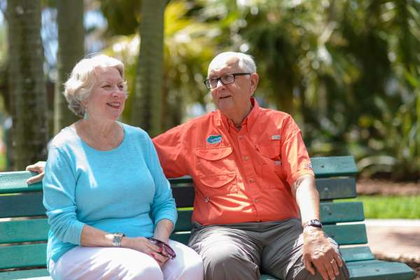 Sarah Hill and her husband, David, sit on a park bench in St. Petersburg.