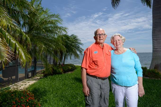 David and Sarah Hill stand together in their lawn at their St. Petersburg home.