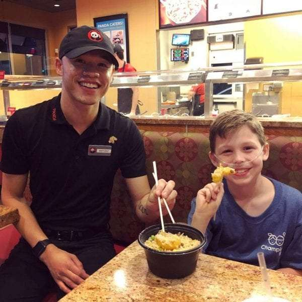 CMN Hospitals Ambassador Nate poses with a Panda Express associate at his local store in Gainesville, FL