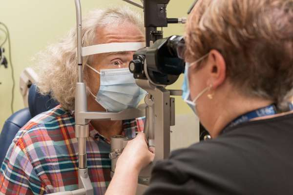 Grateful patient Jon Evans gets his eyes examined at the UF Health Eye Center.