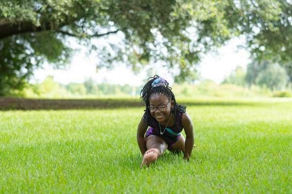 Sydnee showcases her gymnastics skills by doing the splits.